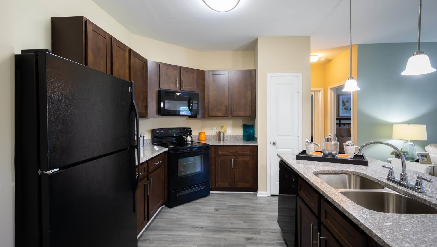 Gourmet kitchen with rich espresso-wood cabinetry in a model home at Legends at White Oak in Ooltewah, Tennessee