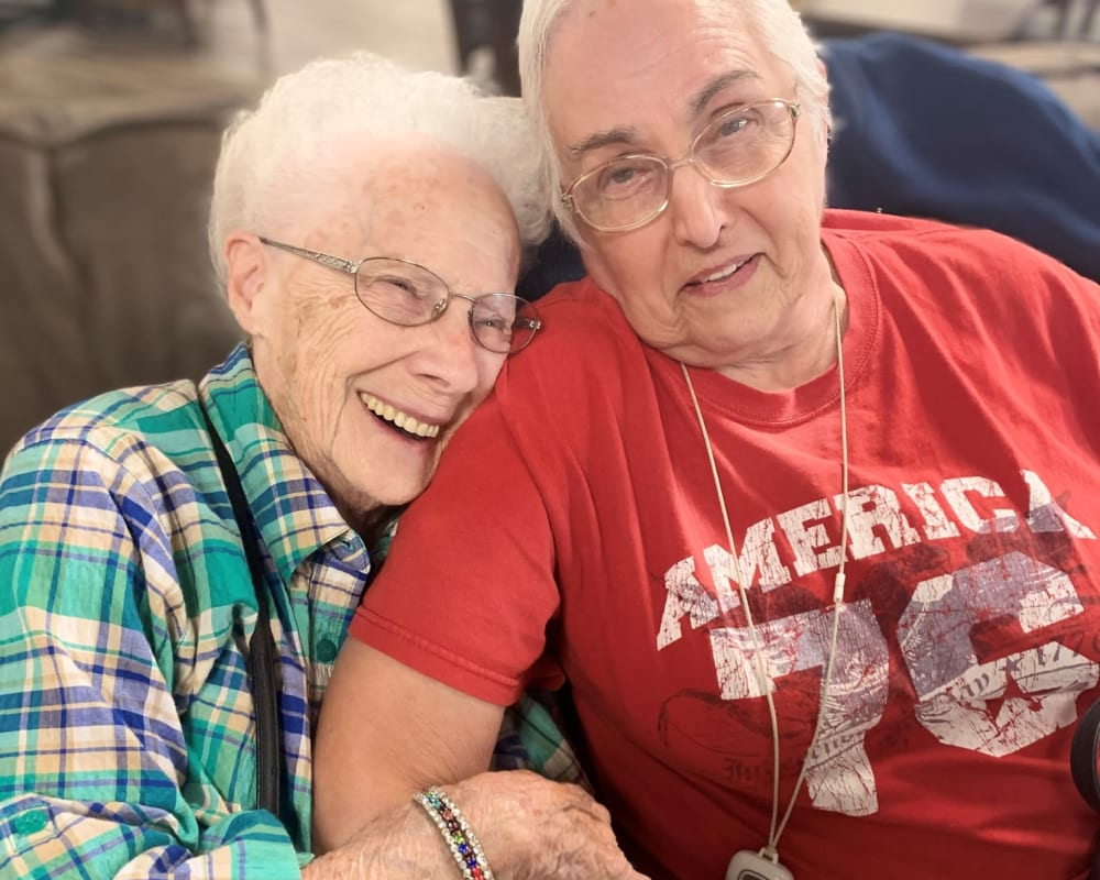 Residents embrace at Corridor Crossing Place in Cedar Rapids, Iowa.