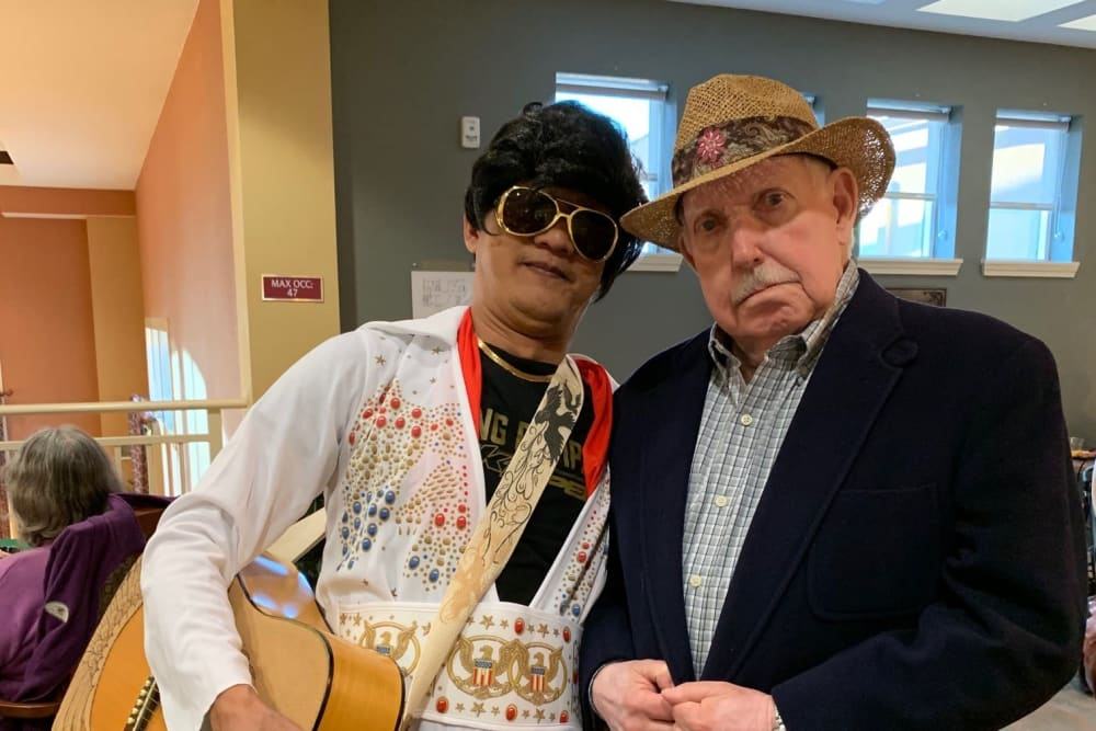 two senior residents at a costume party at The Pines, A Merrill Gardens Community in Rocklin, California.