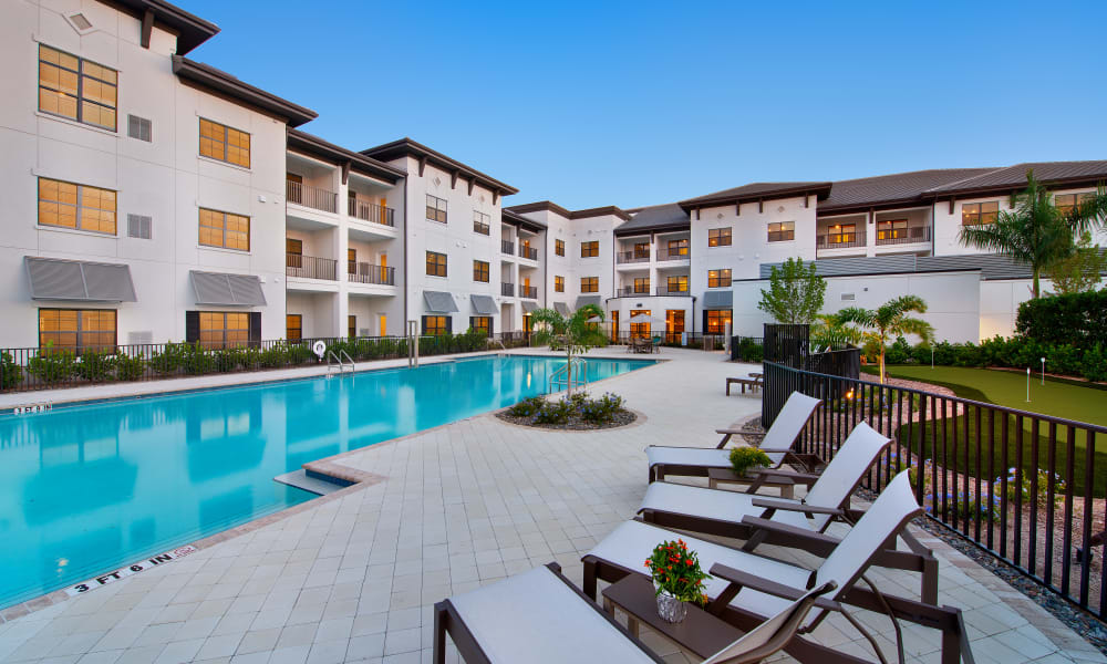 Outdoor pool area at at Keystone Place at Four Mile Cove in Cape Coral, Florida