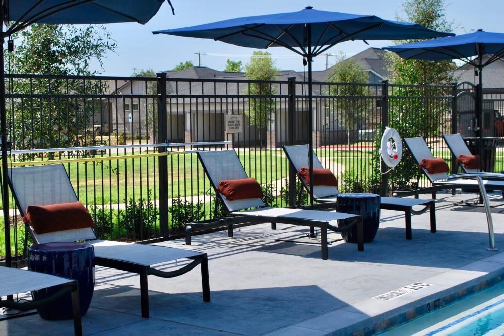Poolside seating at Avilla Heritage