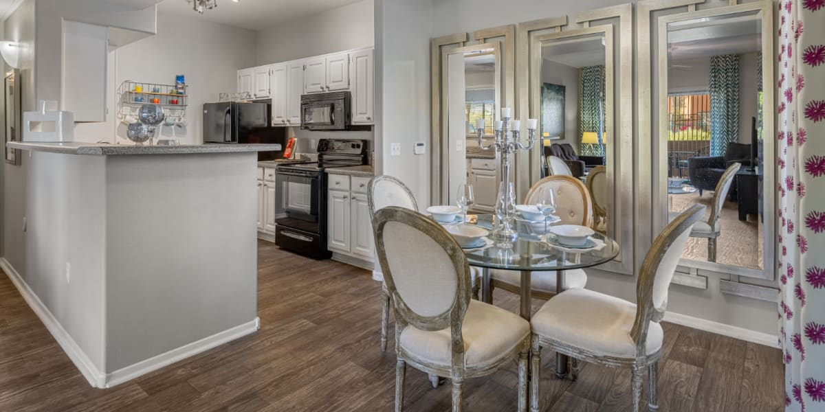 Dining table for four next to kitchen at Alante at the Islands in Chandler, Arizona