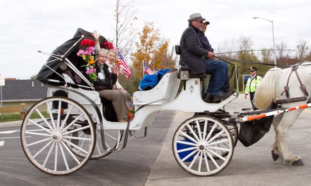 Two residents from Cedarview Gracious Retirement Living in Woodstock, Ontario going for a ride in a horse drawn carriage