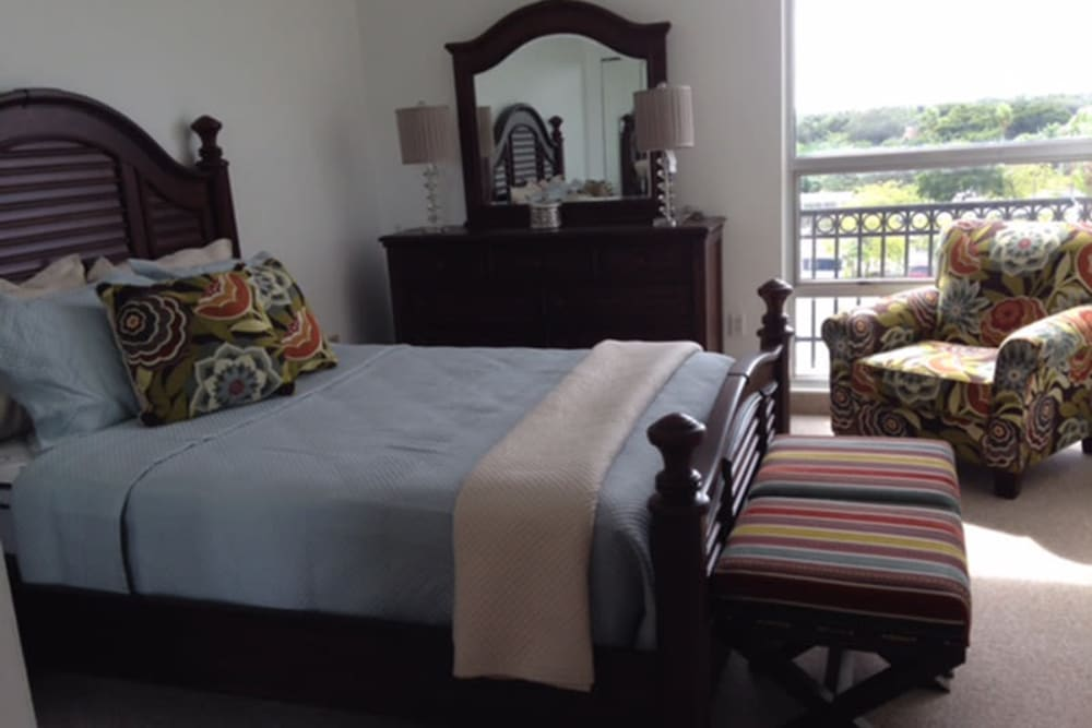 Bedroom with a view of the community at The Peninsula in Pembroke Park, Florida