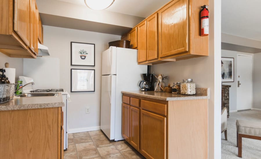 Cool refrigerator and granite countertops in model home at Westgate Apartments & Townhomes in Manassas, Virginia