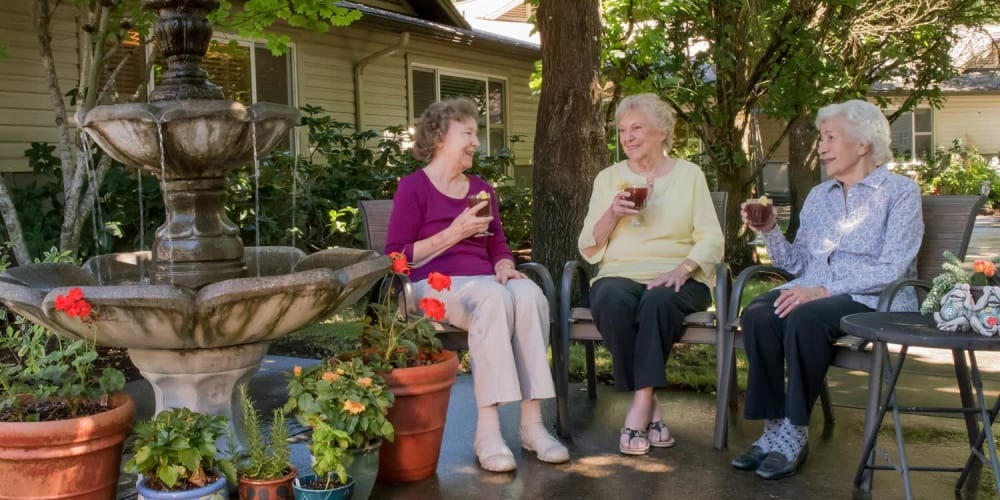 Residents relaxing near a fountain sipping ice tea at The Springs at Wilsonville in Wilsonville, Oregon