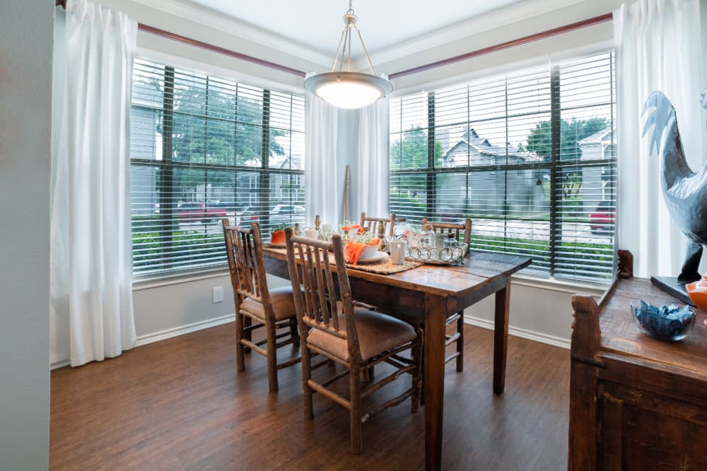 Dining room with wood style flooring at Marquis at Lantana in Flower Mound, Texas