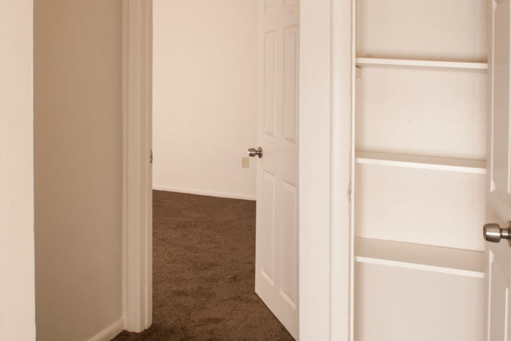Closet and bedroom at Alpine Court East Apartments in Lindenwold, New Jersey
