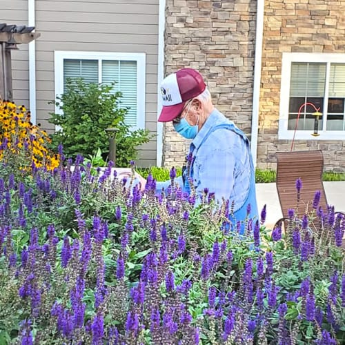 A happy resident gardening at The Oxford Grand Assisted Living & Memory Care in Kansas City, Missouri