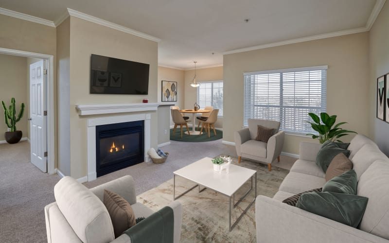 Decorated living room and dining room at Skyecrest Apartments in Lakewood, Colorado