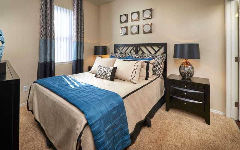 Spacious master bedroom with plush carpeting at Promenade at Hunter's Glen Apartments in Thornton, Colorado