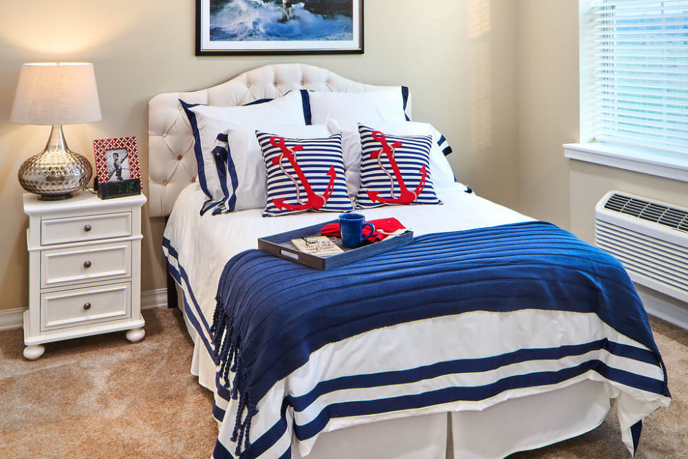 A cozy bedroom at Anthology of Overland Park in Overland Park, Kansas