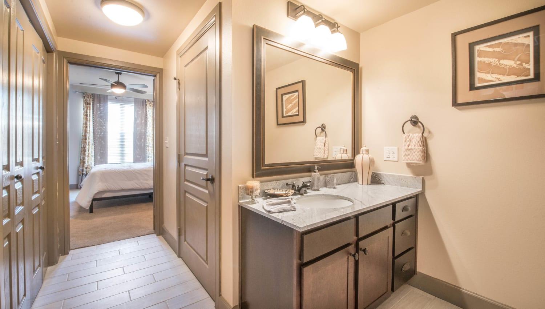 En suite bathroom in a model home's master bedroom at Union At Carrollton Square in Carrollton, Texas
