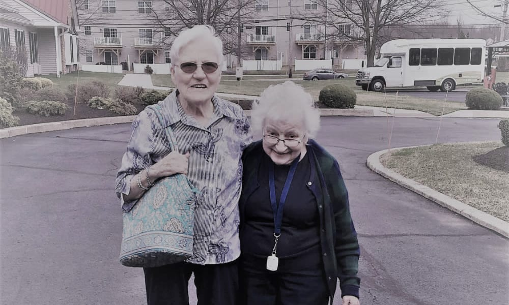 Two residents smiling for the camera at Traditions of Lansdale in Lansdale, Pennsylvania