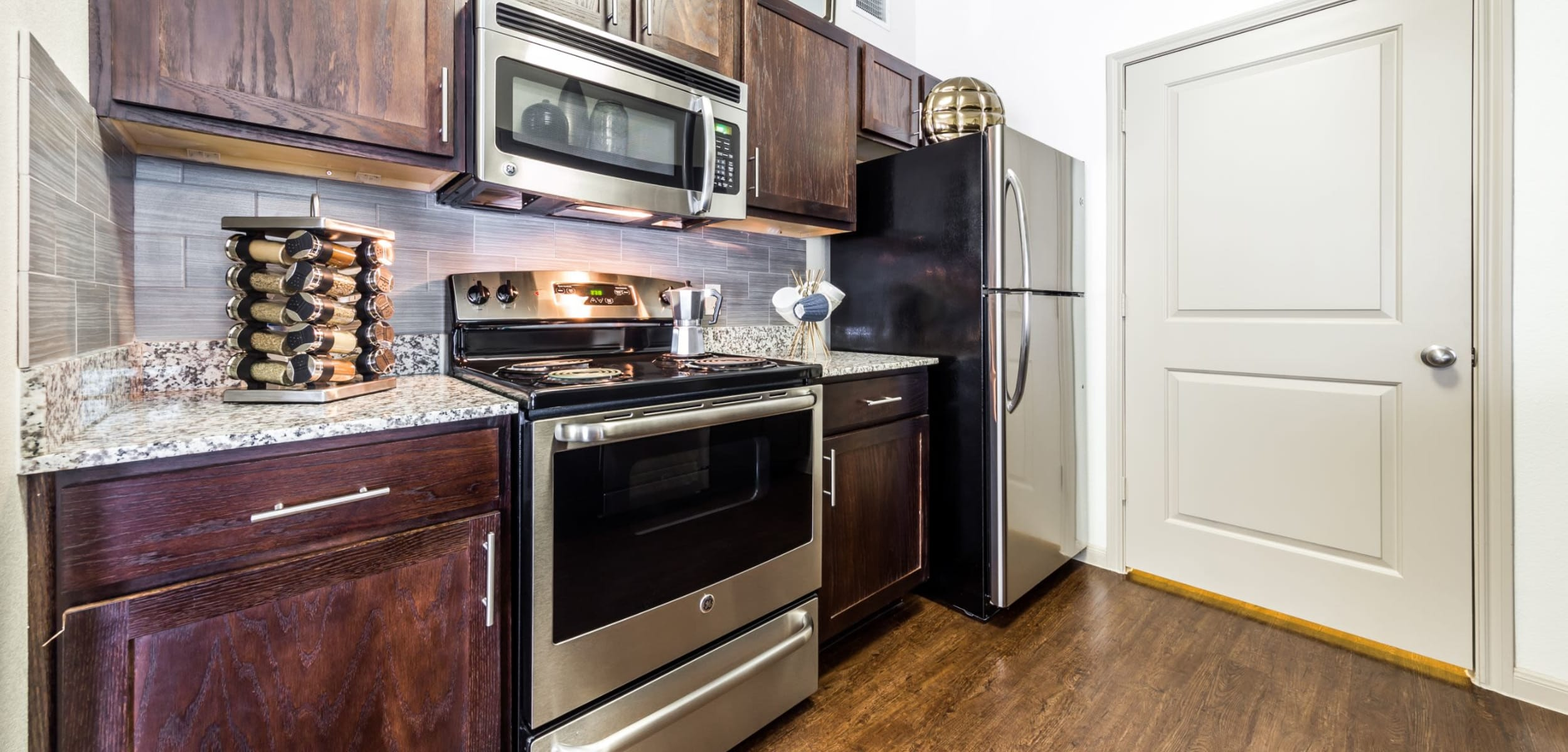 Modern kitchen with stainless steel appliances at Marquis on Lakeline in Cedar Park, Texas