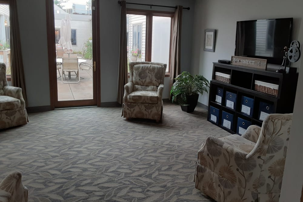 Spacious living area with patio access at The Atrium in Rockford, Illinois.