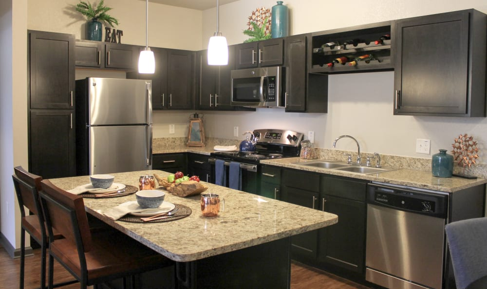 Stainless Steel Appliances and Granite Countertops in the Kitchens