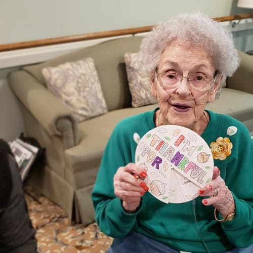 A resident smiling at Canoe Brook Assisted Living & Memory Care in Catoosa, Oklahoma