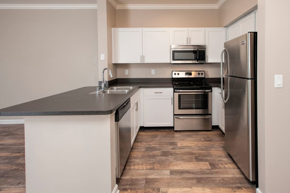 Modern kitchen with stainless-steel appliances at The Vintage at South Meadows Condominium Rentals in Reno, Nevada