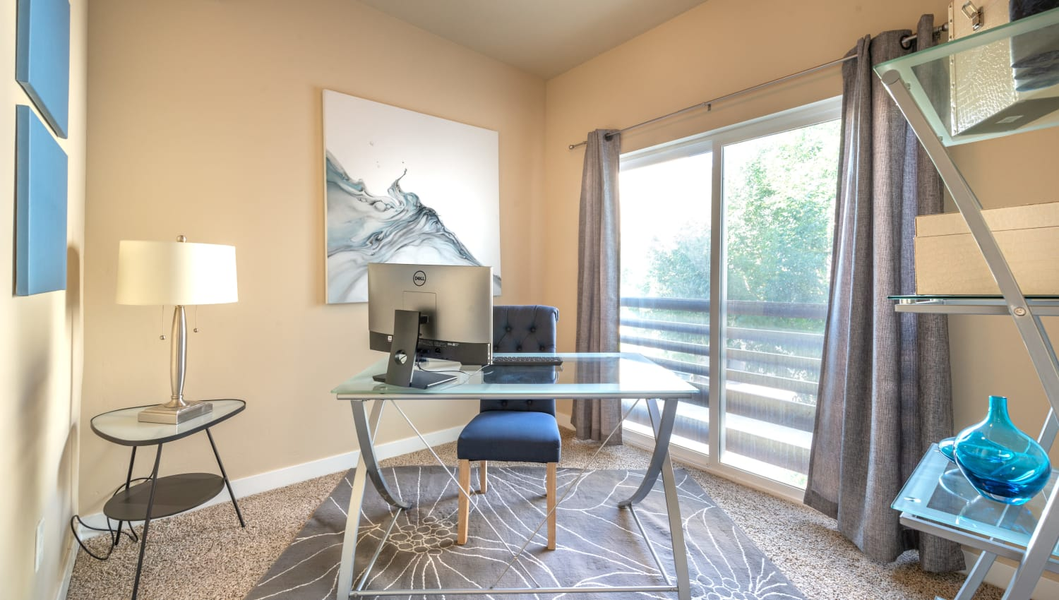 Room at Olympus at the District in South Jordan, Utah with sliding glass doors to balcony