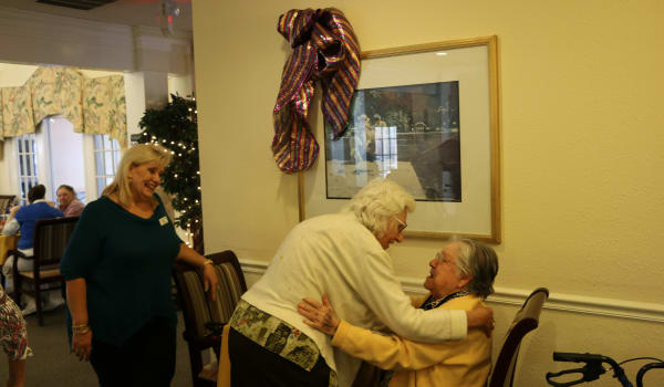 Residents talking to each other at Azalea Estates of Slidell in Slidell, Louisiana