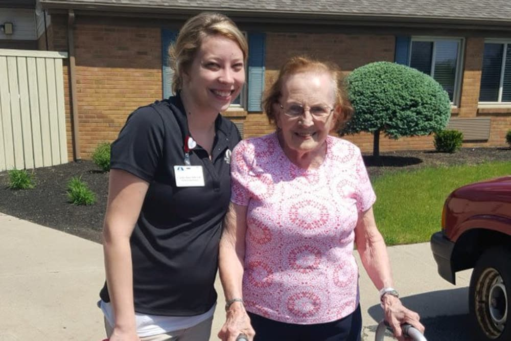 A caretaker and resident outside The Meadows of Leipsic in Leipsic, Ohio