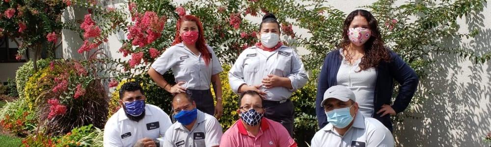 Staff wearing masks at Edgewood Management in Gaithersburg, Maryland