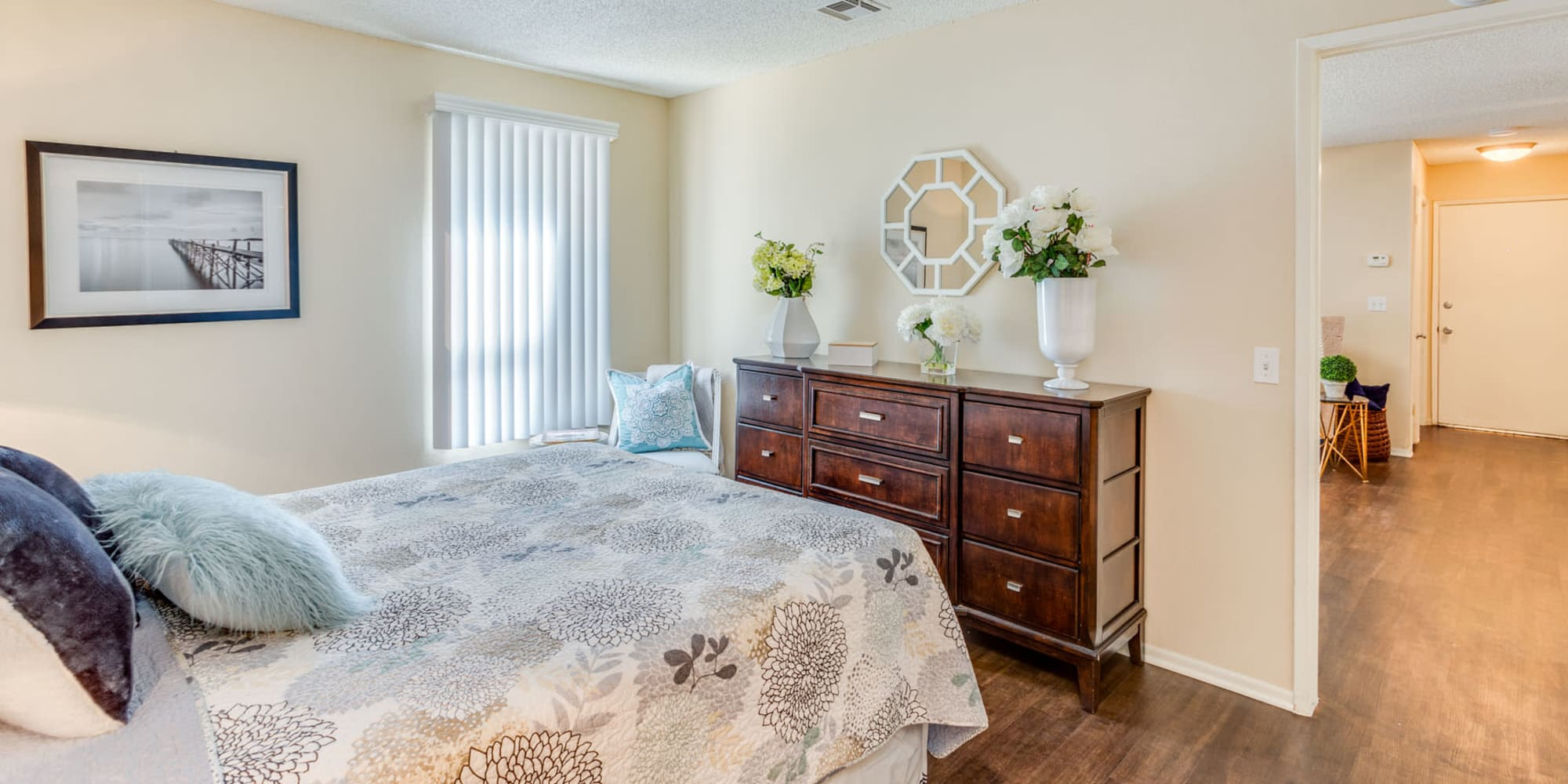 Bay window and classic furnishings in a model home's bedroom at Mountain Vista in Victorville, California