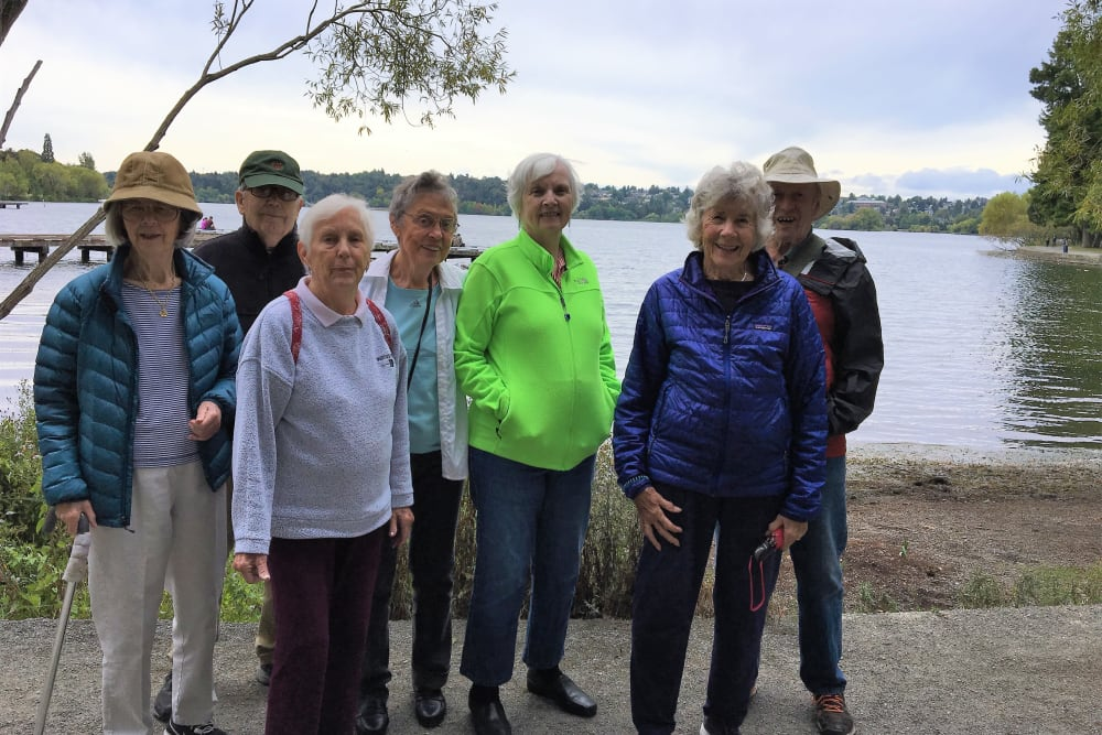 Residents enjoying an outing near Merrill Gardens at The University in Seattle, Washington.