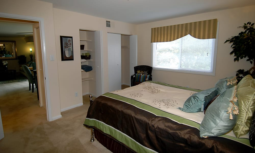 Well lit bedroom at Harbor Place Apartment Homes