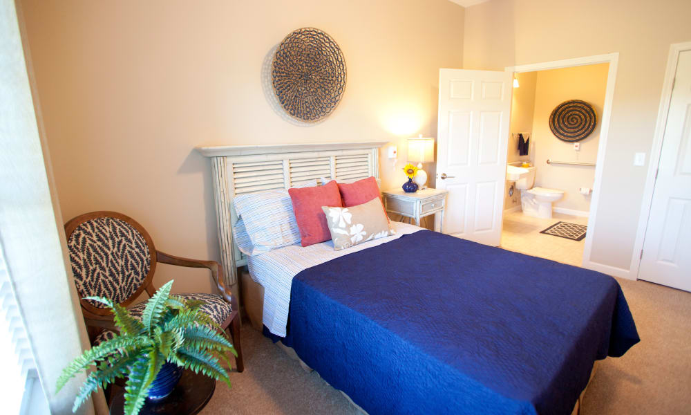 Resident bedroom with an attached bathroom at Keystone Place at Terra Bella in Land O' Lakes, Florida.
