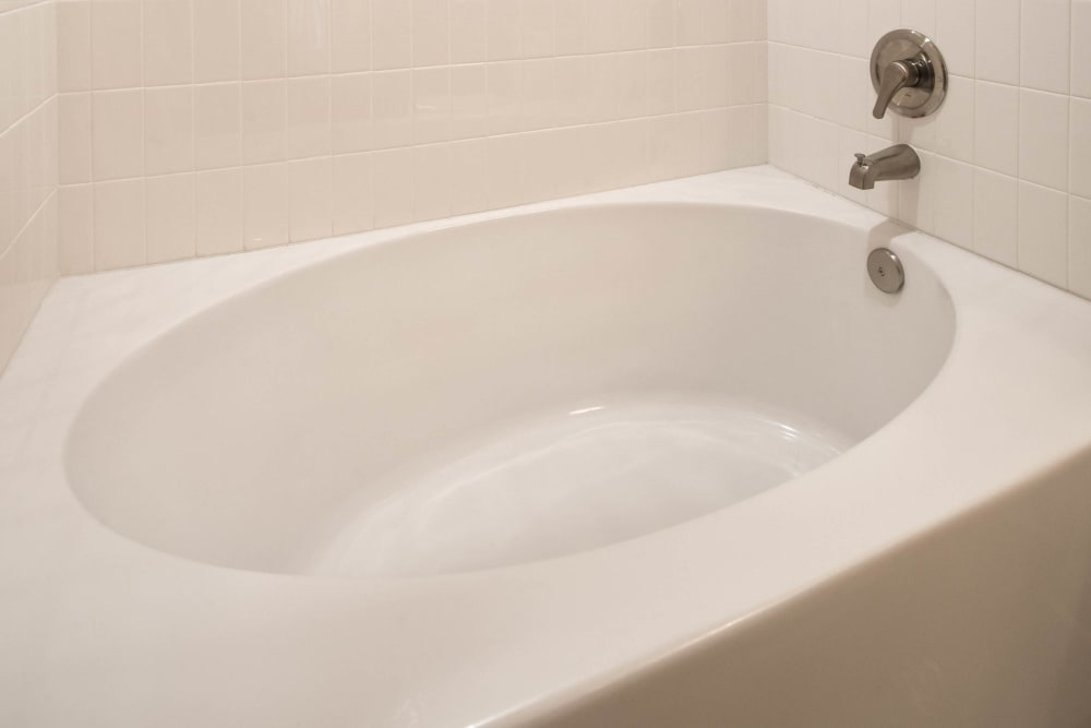 Oval soaking tub in a model home's master bathroom at Olympus Waterford in Keller, Texas