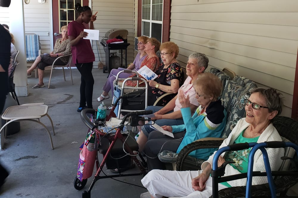 Residents sit on the porch and enjoy time with each other at Landings of Blaine in Blaine, Minnesota