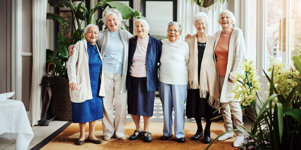 Residents hugging at The Springs Living in McMinnville, Oregon