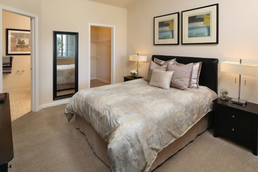 Model bedroom with unique light fixtures at Iron Point at Prairie Oaks in Folsom, California