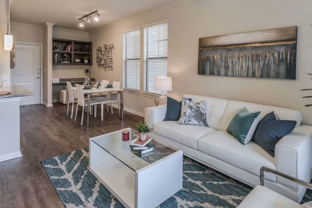Open plan living room and dining area in a model apartment home at Heights West 11th in Houston, Texas
