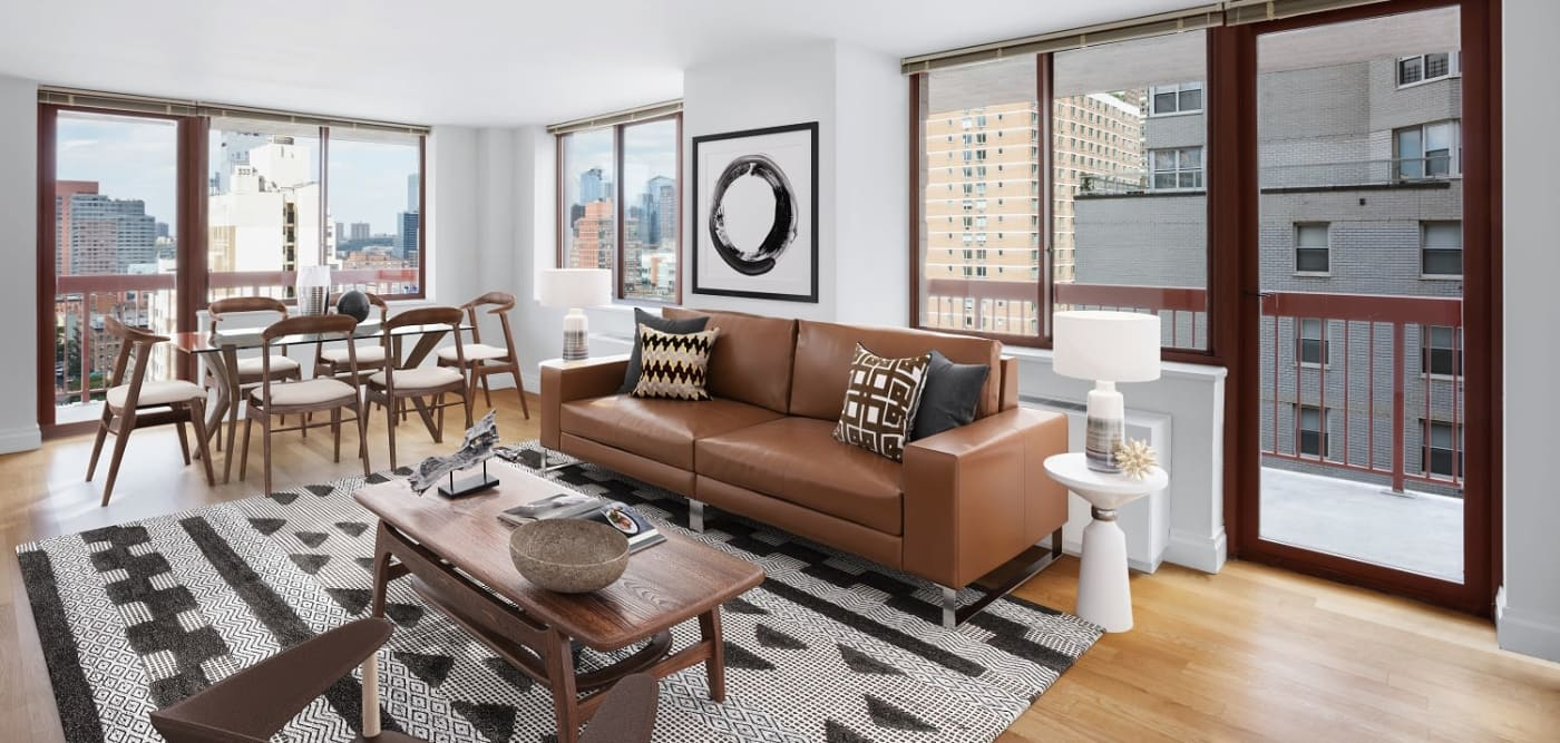 Large open-space living room with wall-to-ceiling windows at The Ellington in New York, New York
