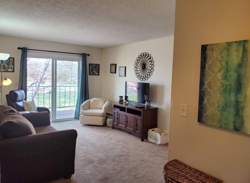 A spacious model living room at Inglenook At Brighton in Brighton, Colorado