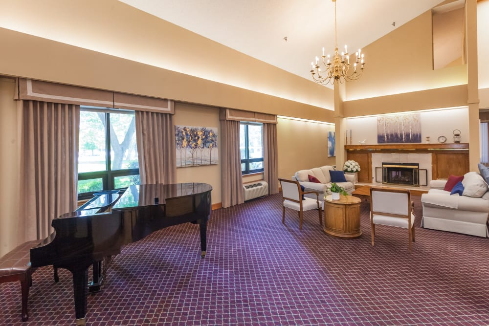 Piano and lots of open space in common area at River Commons Senior Living in Redding, California