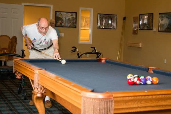 A resident playing pool at Governor's Port in Mentor, Ohio