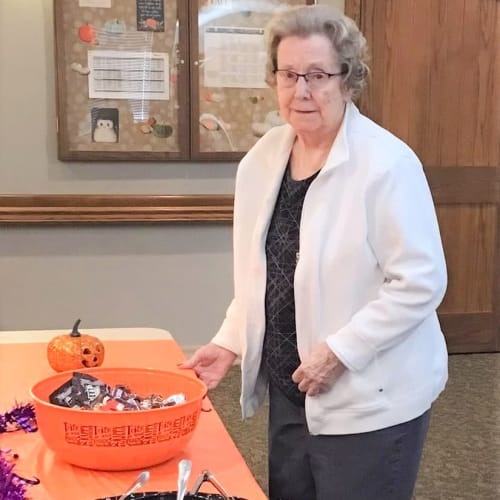 Resident at an event getting some food at Glen Carr House Memory Care in Derby, Kansas