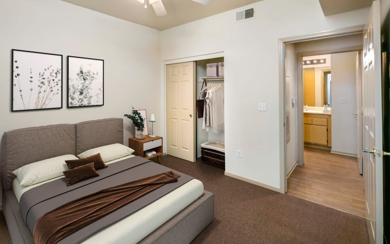 Spacious master bedroom with plush carpeting at Natomas Park Apartments in Sacramento, California