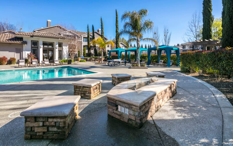 Fire pit and seating area near the pool at Miramonte and Trovas in Sacramento, California