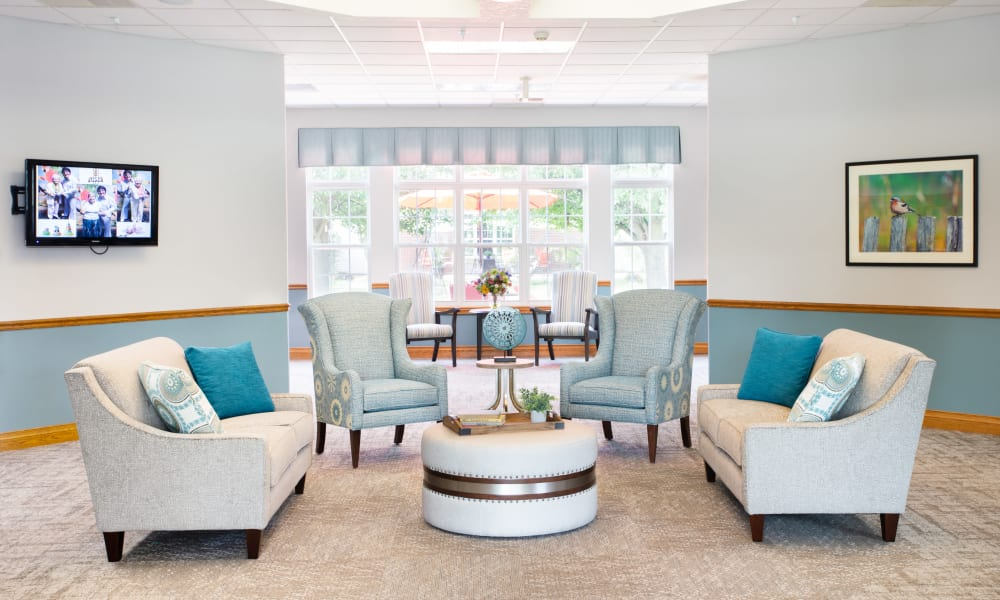 Meeting area with seating and a coffee table at Randall Residence of Decatur in Decatur, Illinois
