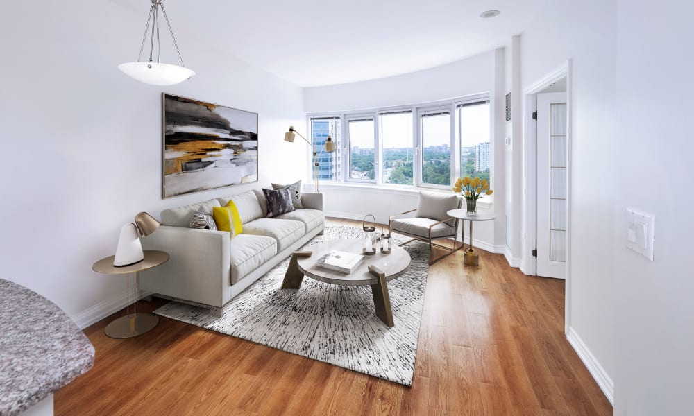 Naturally lit room with hardwood flooring at 50 Laurier in Ottawa, Ontario