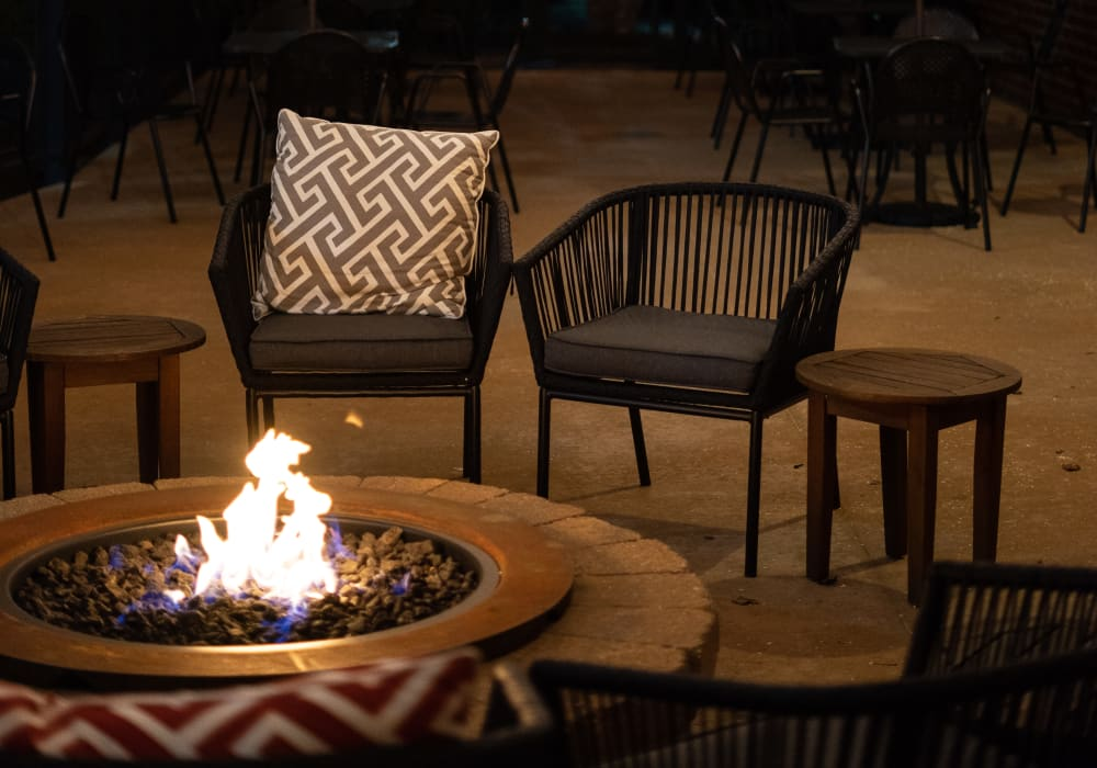 Outdoor fireplace with plenty of seating at LARC at Burien in Burien, Washington