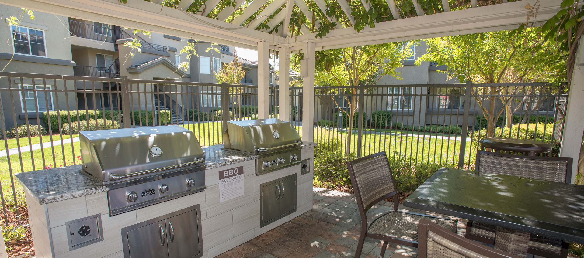 Apartments with a luxury bbq area at The Artisan Apartment Homes in Sacramento, California