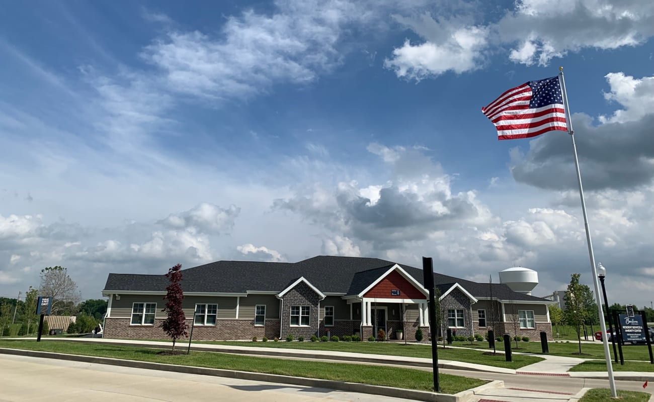American flag waving in the wind at Bonterra Apartments in Fort Wayne, Indiana