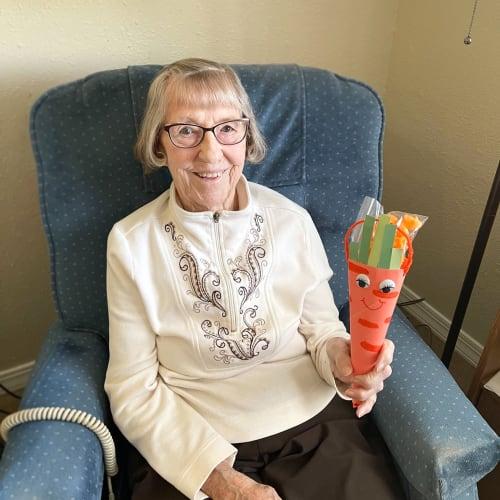 Resident showing off her craft at Madison House in Norfolk, Nebraska