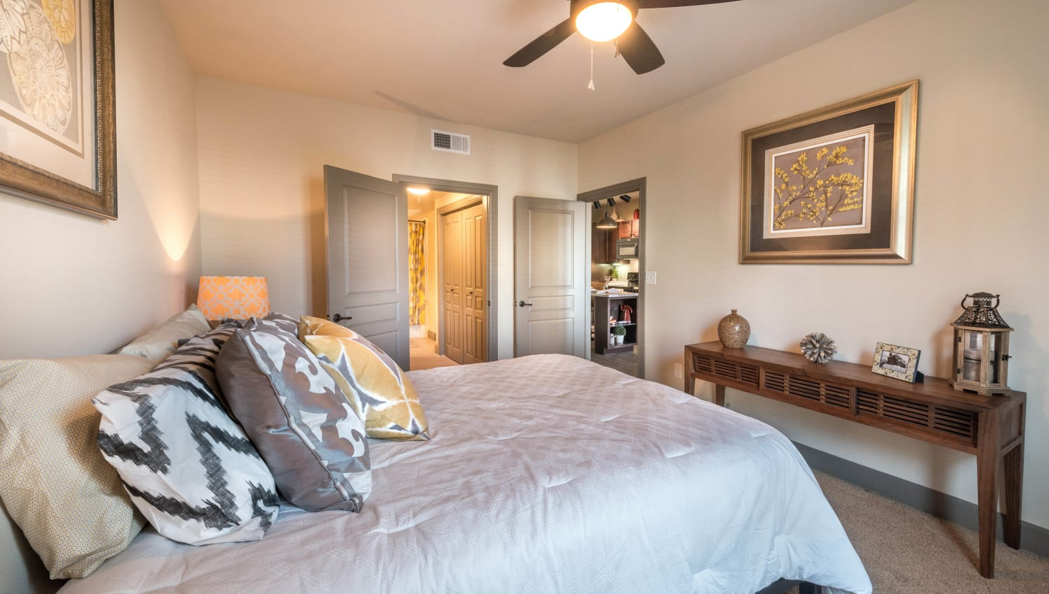 Well-furnished master bedroom in a model home at Union At Carrollton Square in Carrollton, Texas